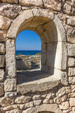 Ancient stone wall with a semicircular window Stock Photography