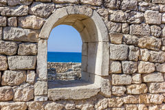 Ancient stone wall with a window Royalty Free Stock Photos