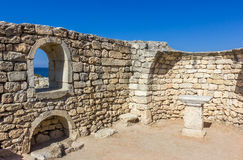 Ancient stone wall with a window and a view of the sea Royalty Free Stock Photo