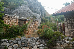 Ancient stone walls in Uchagiz village of Antalys. Ancient stone walls in Uchagiz village of Antalya  and fragment of old stone house Royalty Free Stock Photo