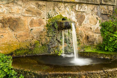 Ancient stone water drinking fountain in Corsica Royalty Free Stock Image