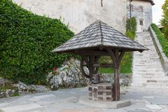 Ancient stone well in Bled Castle Stock Photos