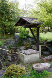 Ancient stone well in japanese garden Stock Photography