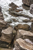 Ancient stones on agitated sea. Conglomerate of old stones near agitated sea in an exotic place Royalty Free Stock Image