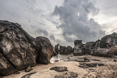 Ancient stones near sea shore in a storm Stock Photography