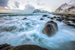 Ancient stones on the shores of cold Norwegian Sea at evening time. Lofoten islands. Beautiful Norway landscape. Royalty Free Stock Photos