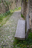 Ancient Stones Street in the Italian Walled City of Soave with Stone Bench. Stock Photos