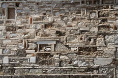 Ancient stonewall background. Stonewall made of ancient pieces of bricks, stones, tiles, amphoras, vessels Royalty Free Stock Images