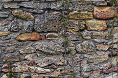 Ancient stonework. Made of rough uneven blocks Stock Images