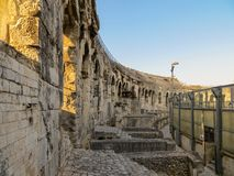 Ancient Stonework in Roman Arena in France. Stone steps, stairwells, and arches inside an ancient Roman amphitheater in southern France Stock Images