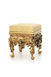 Ancient stool in a gold ornament Royalty Free Stock Photo