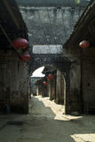 Ancient street with arched gate Stock Photography