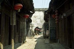 Ancient street with arched gate stock images
