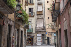 Ancient street and buildings in historic center, ciutat vella, La Ribera quarter of Barcelona. Stock Photos