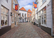Ancient street with cobblestones, Heusden, Netherlands Stock Photo