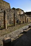 Ancient Street with Columns, Herculaneum. Street view in Ancient Herculaneum. Portrait Mode. Herculaneum was buried in the eruption of Mount Vesuvius in AD 79 Royalty Free Stock Photo