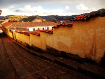 Ancient Street Cusco. Ancient cobble street at sunset in historic Cusco, Peru Royalty Free Stock Photo