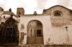 Ancient street. Fragment ancient street  with church, Sardinia. Italy. Sepia Stock Photos