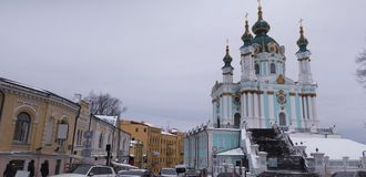 Ancient street in Kiev Andreevsky Descent and St. Andrew`s Church. Winter day Royalty Free Stock Image