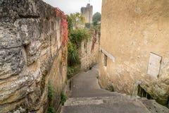Ancient street made of stone named Rue de la Port Saint-Martin,. In Saint-Emilion, France Royalty Free Stock Photo