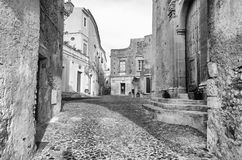 Ancient street in old town of a southern Italy village Stock Photos