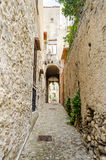Ancient street in old town of a southern Italy village Stock Images