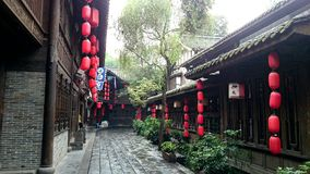 A ancient street with red  chinese lanterns after mild rain Royalty Free Stock Image
