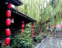 A ancient street with red  chinese lanterns after mild rain Stock Photos