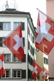 Old street in Zurich, decorated with swiss flags, Switzerland. Ancient street in Zurich, decorated with swiss flags Stock Photo