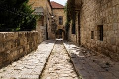 Ancient streets with arch through house in traditional town Deir el Qamar, Lebanon stock photo