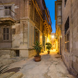 Ancient streets in Vittoriosa in Malta. Ancient streets in Vittoriosa, small village on the shores of Grand Valetta Bay in Malta, on a quiet evening Royalty Free Stock Images