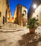 Ancient streets in Vittoriosa in Malta. Ancient streets in Vittoriosa, small village on the shores of Grand Valetta Bay in Malta, on a quiet evening Stock Photography