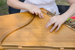 Ancient stringed baltic psaltery and girls hands Royalty Free Stock Images