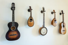 Ancient stringed musical instruments on wall. stock image