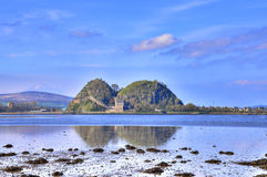 Ancient Stronghold. View at low tide across the  river Clyde of Dumbarton rock and castle, ancient stronghold and capital of Strathclyde, Scotland Royalty Free Stock Image