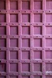 Archtecture texture - wooden door detail. Ancient studded fortified wooden door detail Stock Photos