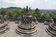Ancient stupa at Borobudur is a 9th-century Buddhist Temple in Yogyakarta, Central Java, Indonesia royalty free stock photography