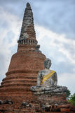 Ancient Stupa and Buddha Statue. In Ayutthaya, Thailand Royalty Free Stock Photo