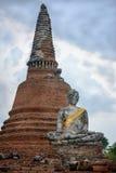 Ancient Stupa and Buddha Statue. In Ayutthaya, Thailand royalty free stock photo