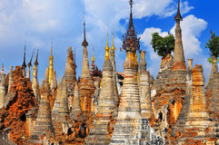 Ancient stupa ruins Indein in Myanmar. Shwe Inn Thein Paya, Indein, Burma. Weather-beaten Buddhist zedi constructed in 17th and 18th century damaged by Stock Photography