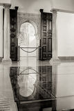 Ancient style. Arabian style interior door reflected by a glass placed on the ground Royalty Free Stock Photos