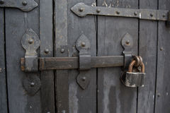 Ancient style door fragment with the lock in the church Royalty Free Stock Images