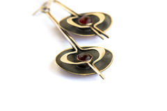Ancient style earrings with garnet Stock Image