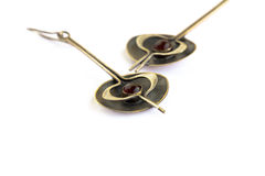 Ancient style earrings with garnet Stock Photography