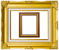 Ancient style golden photo image frame. Ancient style golden wood photo image frame isolated on white background stock image