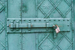 Ancient style metal door with lock in the church Stock Photo