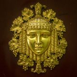 Ancient style modern golden mask. Gold face decoration detail royalty free stock photography