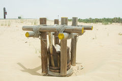 Ancient style well in the desert Stock Image