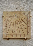 Ancient sundial or sun clock on a wall Stock Photography
