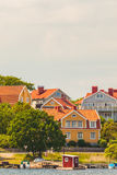 Ancient swedish houses in the seaside bay of Karlskrona Stock Photo